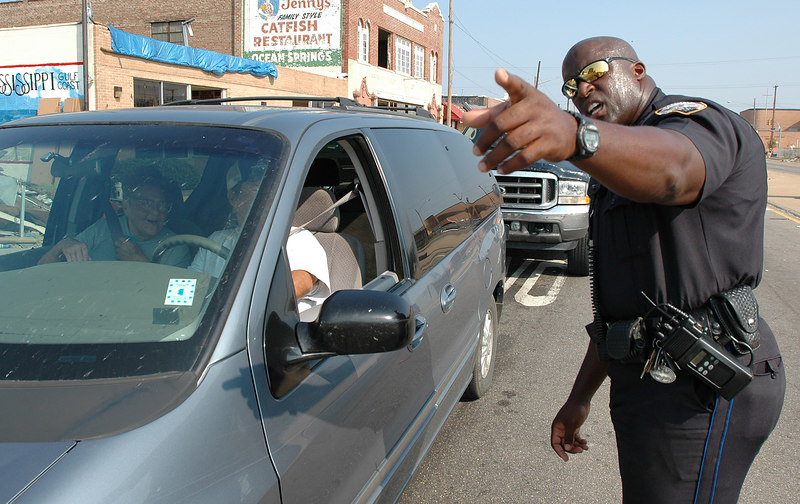 Gulfport police officer Damon McDaniel directs traffic at a checkpoint on U.S. 49 near U.S. 90 in Gulfport Friday. Officials have tightened the security around the damaged areas from Biloxi to Bay St. Louis.