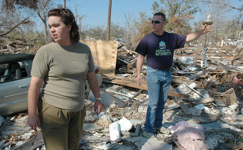 Kathy Brugger-Volkman looks over the remains of her parents's home, Harbour Oaks, on W. Scenic Drive in Pass Christian while her husband, John Volkman, holds up a lamp he's found. Her father was killed when the house collapsed during the storm and her mother survived by holding on to a tree.
