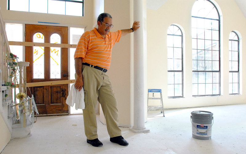 Charles Beckwith talks about the damage to his home in New Orleans' Ninth Ward. The house, which recieved about three feet of water when the area flooded after Hurricne Katrina, is currently undergoing repairs.
