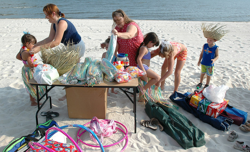 Parents prepare their children for a birthday party on the beach in Biloxi Saturday as many residents are preparing to leave the area in advance of Hurricane Katrina which is forcast to hit the Gulf Coast Monday.