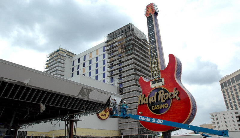 Workers with Belfor Property Restoration make repairs to the the outside of the new Hard rock Casino in Biloxi on U.S. 90 Wednesday.