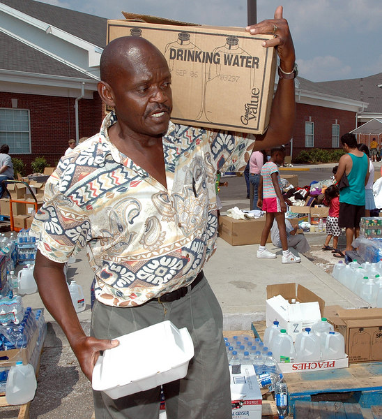 Milton Wood of Biloxi carries away boxs of drinking water and hot food provided by the Red Cross at the First Baptist Church of Biloxi Wednesday.