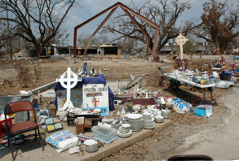 These recovered items, a cross and a metal frame are all that is left of the building of the Episcopal Church of the Redeemer in Biloxi. The memorial to the victims of Hurricane Camille on the grounds of the church was also heavily damaged.