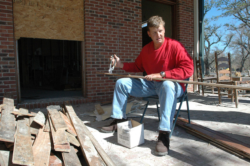 Contractor Todd Presley of Pascagoula pulls nails from antique slats of a wooden floor at a home on 1411 Beach Boulevard in Pascagoula. Presley said the owner of the home hoped to salvage the flooring which was said to be at least 100 years old.