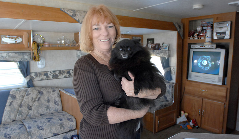 Eighteen months after Katrina, Bonnie Lambert and her dog Suggar are still living in a trailer on St. Charles Avenue in Biloxi where her home once stood.