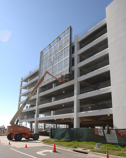 Workers paint the framework for a sign on the parking garage of the Hard Rock casino along U.S. 90 in Biloxi.
