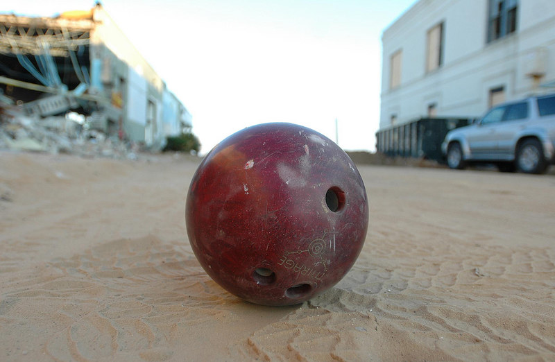 A bowling ball sits, nowhere near a bowling ally, in the middle of a sandy Main Street in downtown Bay St. Louis Sunday.