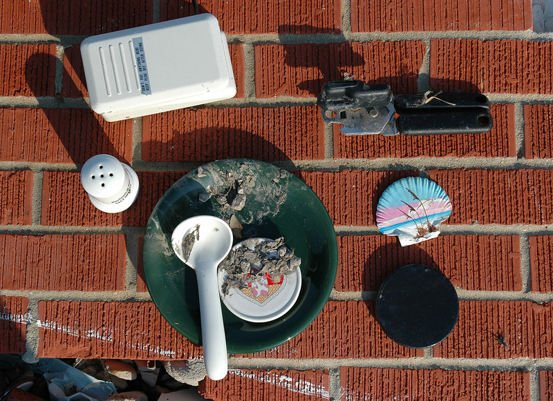 Lorna Richardson set some of the valuables she recovered from her home on West Ave. in Long Beach Sunday after Hurricane Katrina destroyed the building, along with the other homes on the street, Monday.