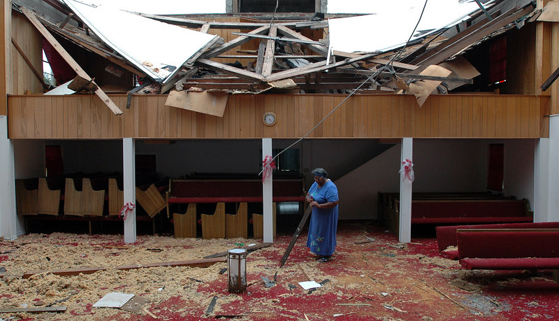 Mary A. Wilson, a paritioner and volunteer worker at St. John Baptist Church on 28th Street in Gulfport, looks over debris in the sanctuary of the church that had it's roof ripped away by Hurrican Katrina almost 3 weeks ago.