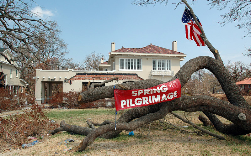 A sign, with tongue firmly planted in cheek, announcing the Spring Pilgrimage is tied to a tree outside a heavily damaged home along the U.S. 90 in Biloxi Thursday.