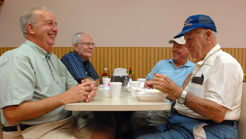 Pascagoula residents (from left) Spencer Bailey, Mike Williams, Robert Elam and S.N. Hudson talk about the status of their grants over breakfast at Jerry Lee's Grocery & Market in Pascagoula.