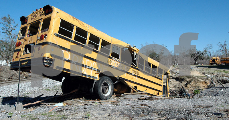A damaged Pass Christian school bus sits in a sink hole washed out by the tidal serge of Hurricane Katrina near the railroad tracks two blocks from the Gulf.