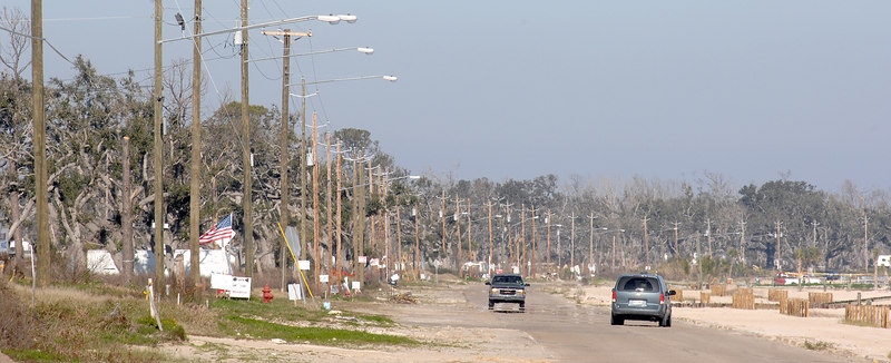 Lines of new utility poles and signs, and very little else new, line Beach Boulevard from Waveland to Bay St. Louis.