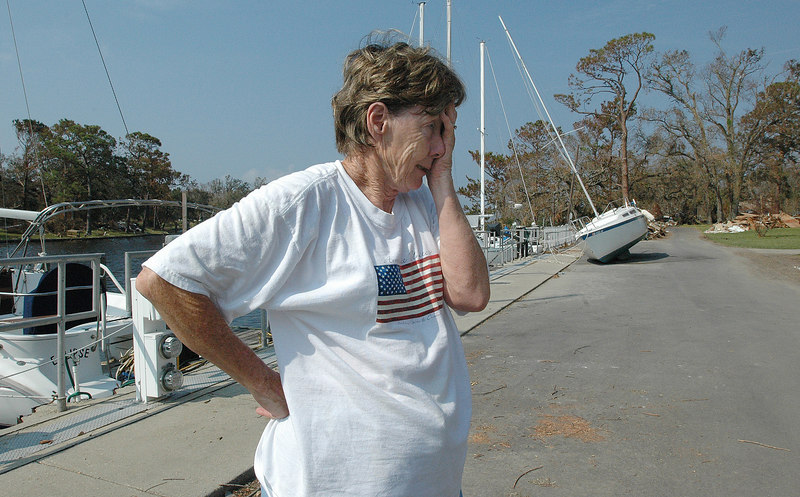 Anita Belcher covers her face as she talks about the water damage inside her home near the marina on Wade Ave. in Pascagoula. Belcherand her husband Keith, said the water reached the eves of her home, and also damaged two cars and a motorcycle.