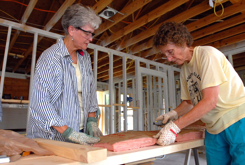 Martha Martin (left) and Donna Atkins with the United Methodist Church of Sanford, N.C., cut insulation in the home of Eagle Finegan in Bay St. Louis. The women are working out of the Camp Gulfside Mission based in Waveland which arranges for church volunteers to help residents repair or rebuild their homes.