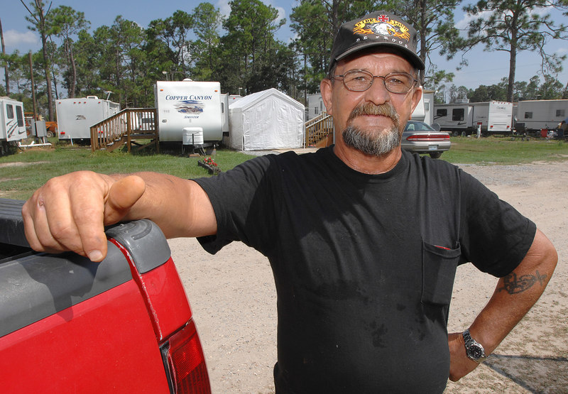 Daniel Rushing has been living in one of the tailers behind him with his wife Brenda at the Five Star Resort off Freddie Frankie Road in Harrison County since October after their Pass Christian home was destroyed by Hurricane Katrina.
