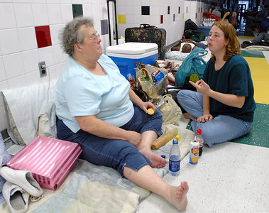 Karlina Chachere (left) and Susan Chachere of Biloxi talk in a shelter at the North Bay Elementary School in Biloxi as they wait for Hurricane Kathrine to make landfall Sunday.