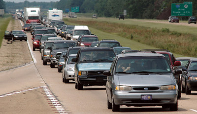 Traffic headed east from Louisiana and the Mississippi Gulf Coast was thick by moving at a steady pace late Sunday as people fled Hurricane Katrina.