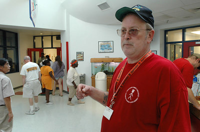 Mike Jelinski of Biloxi talks about being in charge of the hurricane shelter in the North Bay Elementary School in Biloxi Sunday.