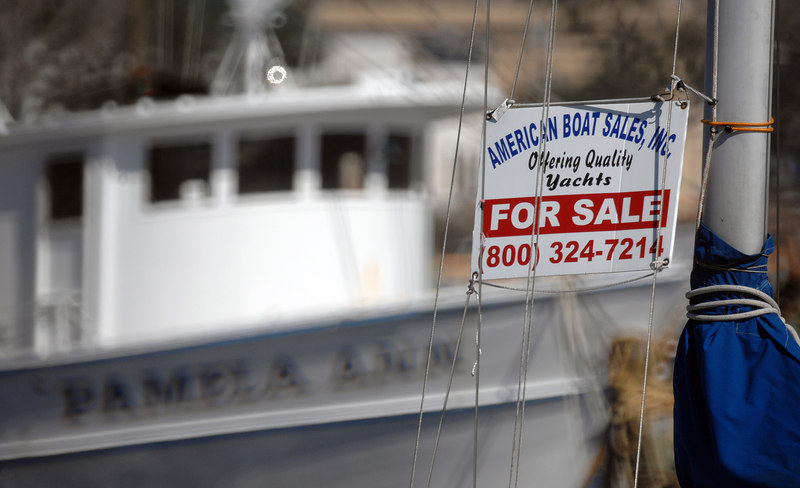 The small craft harbor in Pass Christian has only a few slots that are filled, and For Sale signs on many of the boats there.