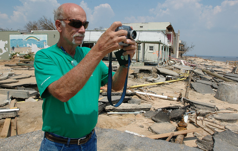Jack Deal with Georgia Power takes photographs of what used to be South Beach Boulevard in downtown Bay St. Louis Sunday. Hurricane Katrina batterd the area Monday, destroying buildings and with high wind and a large storm surge.