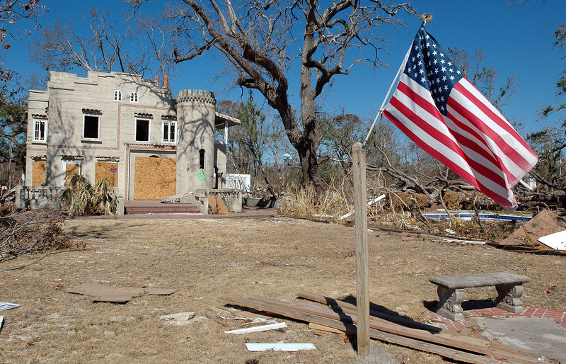 An American flag flies in the yard of one of the few historic homes left standing along the beach on U.S. 90 in Pass Christian. The Castle was built in 1922 and was added to the National Register of Historic Places in 1979.