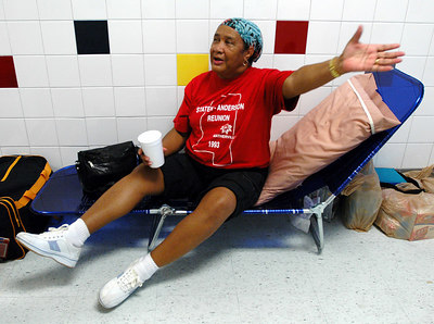 Laura McKinney of Biloxi talks about having to leave her home just a few miles away Sunday as she waits in a shelter at the North Bay Elementary School in Biloxi for Hurricane Kathrine to make landfall.