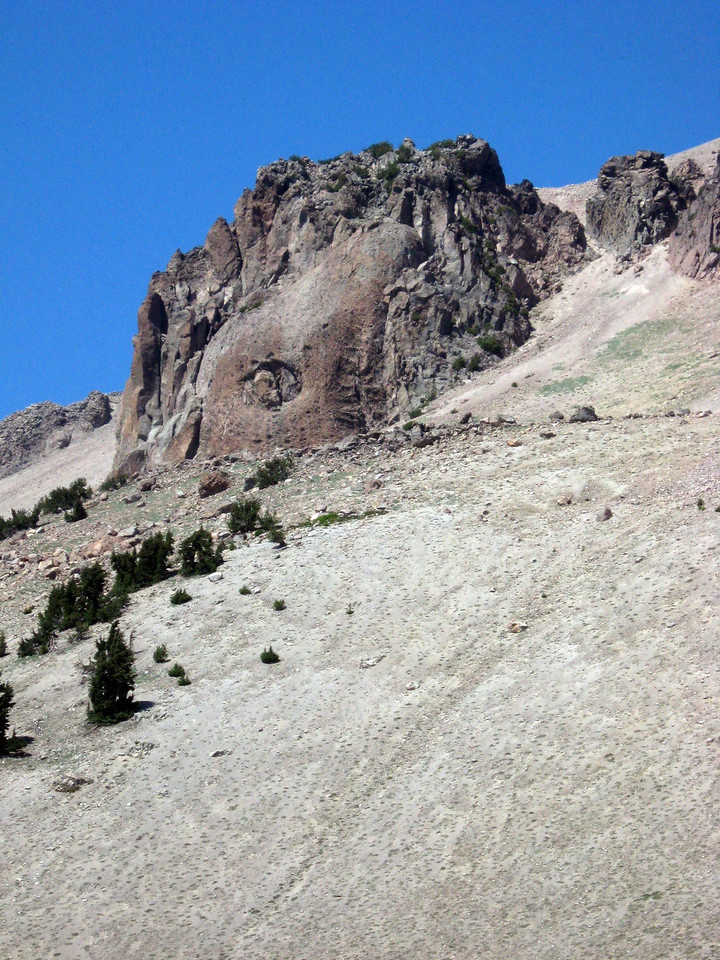 """A mound of dacite lava extruding upward on Lassen Peak--""""Vulcan's Eye""""--like toothpaste from a tube."""