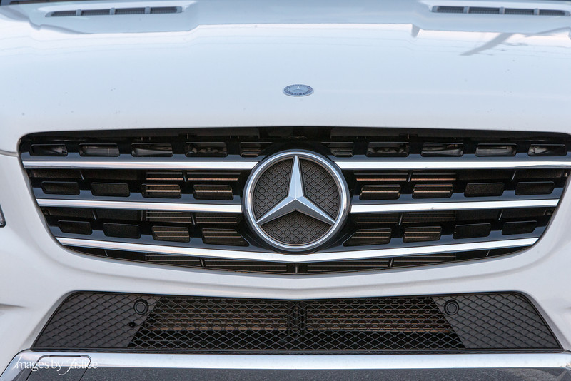 148mm f/10 bacground compression makes the car look flat.  Depth of field creates crispness.