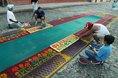 "An alfombra (that's Spanish for ""carpet"") is created out of colored saw dust, sand and a few secret ingredients on a street in Antigua, Guatemala on March 17, 2013 in preparation for a procession that will walk right over it and destroy it. Photo by Scott Umstattd"