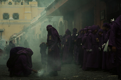 Lent processioners stop to light incense on the streets of Antigua, Guatemala on February 17, 2013. Photo by Scott Umstattd