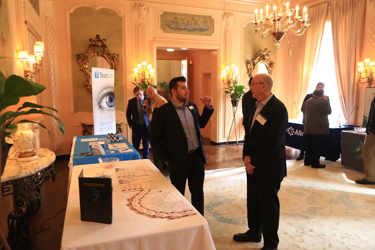Don Schwartz talking to exhibitor