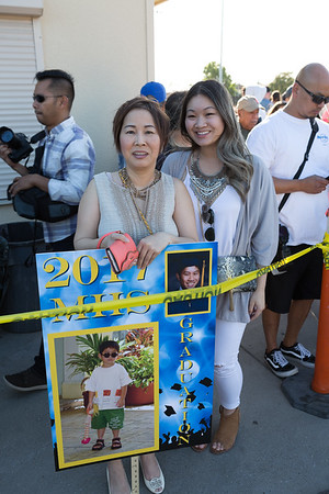 Chi Nguyen (mom) and Natalie Dang (sister) cheering for brother Nathan Dang.