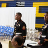 (L->R) Sergeant Castillo and Sergeant Guevara waiting to hand over Awards to Students with musical excellence, Athlete of the year (M, F).