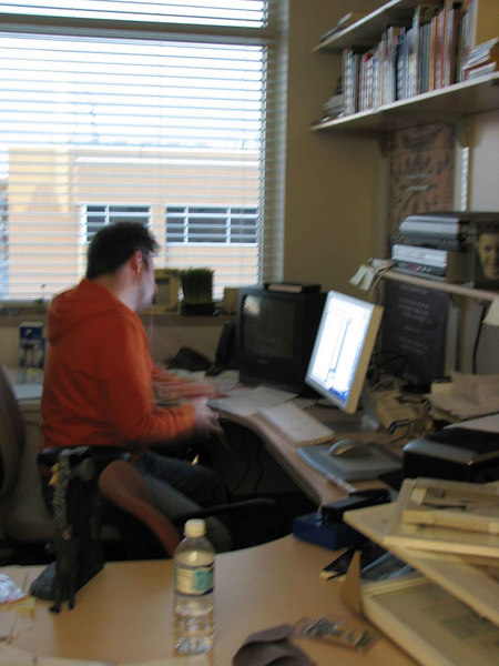 a blurry shot of Marc working at his desk, but I think it still captures him in his element