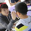 Helen Cui does a face painting for Edward (4th Grader)
