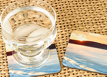 Coasters come in sets of 4 (only two are shown in this photo) and measure 3.75 x 3.75 inches. Durable, hard and glossy surface with cork back. They're slightly more than 1/8th inch thick. <br /> <br /> $5.99 each, order in sets of 4. Text can be included. Contact Robert for orders.