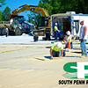 South Penn Resources LLC. team spreading, seaming and crafting contamination membrane on shale exploration well site.