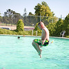 Morgan Queenan taking a dive from the pool board @ the Milpitas Yosemite Cabana Club