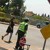 Crossing Guard Theresa Thomas helping pedestrians cross the road.