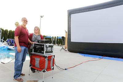 Dale Flunoy Recreation Supervisor city of Milpitas and Renee Lorentzen Recreation Services Manager, starting the projector for the nights movie.