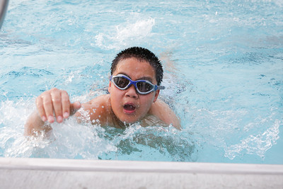 Damon Phan doing some laps across the pool.
