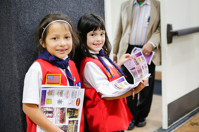 American Heritage Girl volunteers Lola Guerrero & Madelene Schussman distributing event flyers.