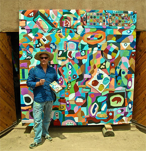 "SCOTT CHRISTOPHER IN FRONT OF HIS 8'X8' PAINTING TITLED ""CHROMOSOME #8"" JULY, 2012. THIS PAINTING IS PART OF A TWENTY FOUR PAINTING SERIES THAT WILL MEASURE APPROXIMATELY 16'X40' WHEN COMPLETED. THE PURPOSE OF THIS WORK IS TO EXPLORE THE BEFORE, DURING, AND AFTER OF OUR EXISTENCE, ON MANY LEVELS - NOT JUST THE GENETIC CODING. I BUILD THE FRAMES AND COVER THEM WITH VARIOUS TYPES OF CARDBOARD. I PAINT THEM WITH A SPECIAL BONDING MIXTURE, AND THEN CARVE THEM WITH A CHISEL, BEFORE I BEGIN PAINTING. I HAVE ENJOYED CREATING THIS SERIES VERY MUCH. I BEGAN THIS CREATIVE PROCESS IN NOVEMBER 2011. WHEN COMPLETED, MY MURAL, WILL BE APPROXIMATELY 16'X40'."