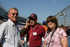 Alan Norman of Cy Fair Propane  of Cypress with Kendall Brandon of  Kendall taylor Construction of Cypress and Nancy Norman squeeze a pit tour before the commencement of Sunday's race.