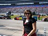 Latrice Dyer of Hart, TX poses next to her favorite racer's car, none other than # 24 Jeff Gordon.
