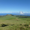 The view north to Maui, with the community of Hawi on the near shore.
