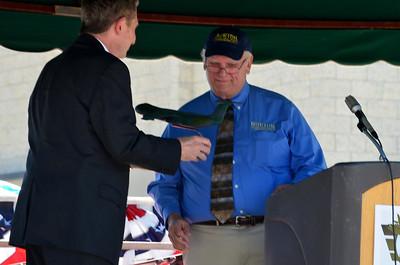 Bob Edwards giving a thank you gift to AJ Wilson.