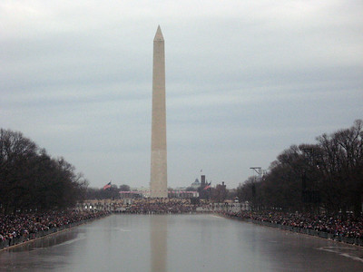 The frozen reflecting pool with the Washington Monument in the distance and crowds massing at left and right--horizontal view, more detail.