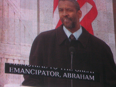 Denzel Washington presents prepared remarks.